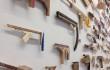 wood guns on display on a wall
