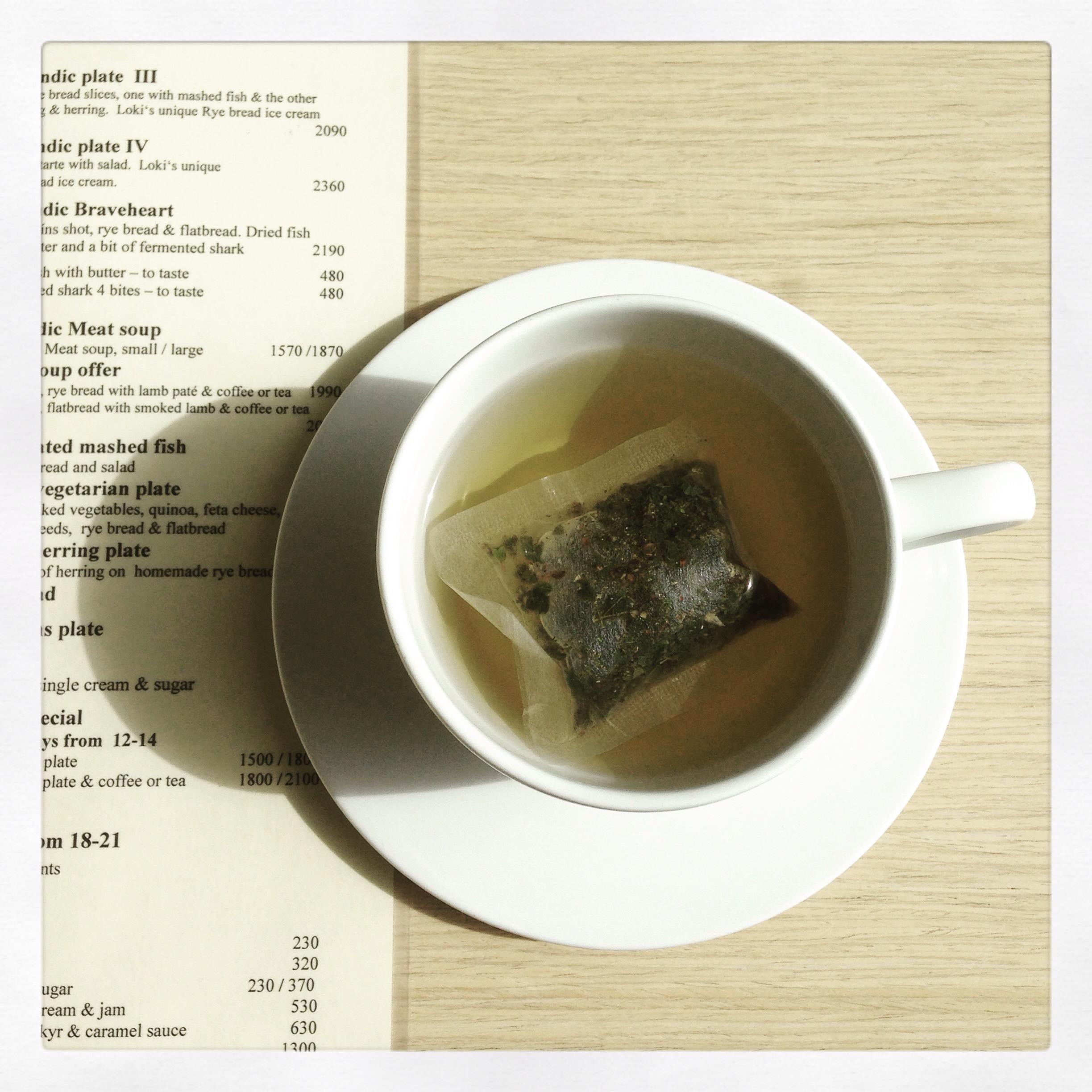 cup of tea next to Cafe Loki's menu