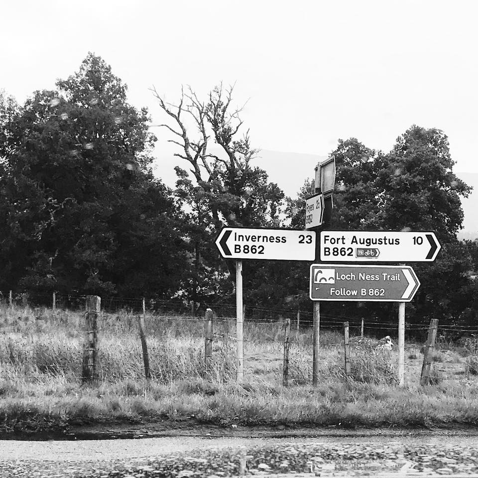 Photo of road signs pointing to Iverness, Fort Augustus and the Loch Ness Trail