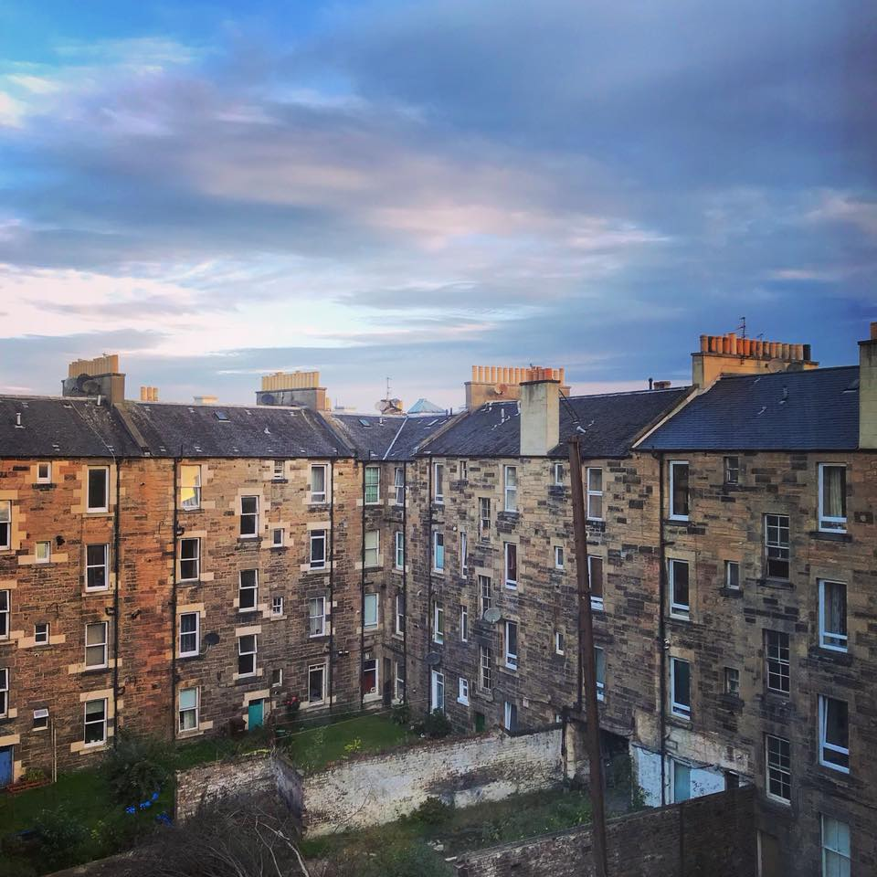 Photo of old stone apartment buildings in the morning light